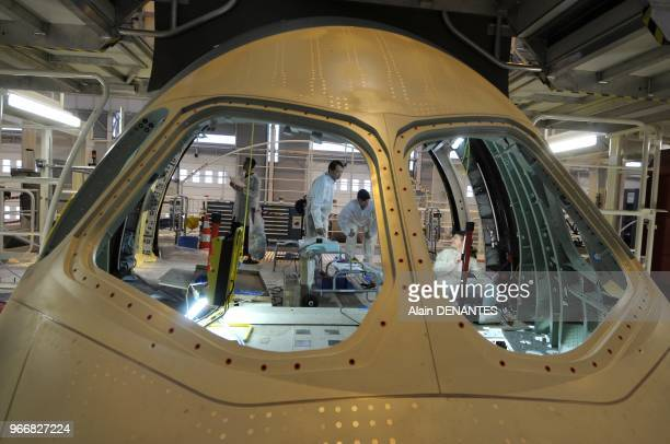 The forward fuselage of the new Airbus A350 XWB is assembled at the Airbus plant in SaintNazaire western France on December 19 2011 The sections of...