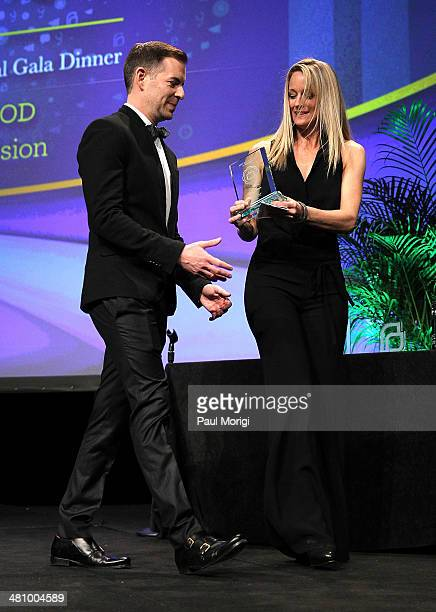 The Fosters Executive Producer Brad Bredewegi presents actress Teri Polo with the Maggie Awards for Television at the Planned Parenthood Federation...