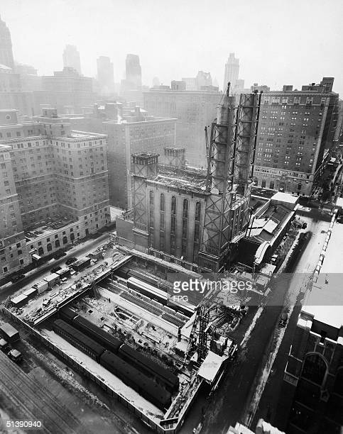 The foundation for the new Waldorf-Astoria Hotel is laid between the railroad tracks at the site of the New York Central Power House, New York, New...