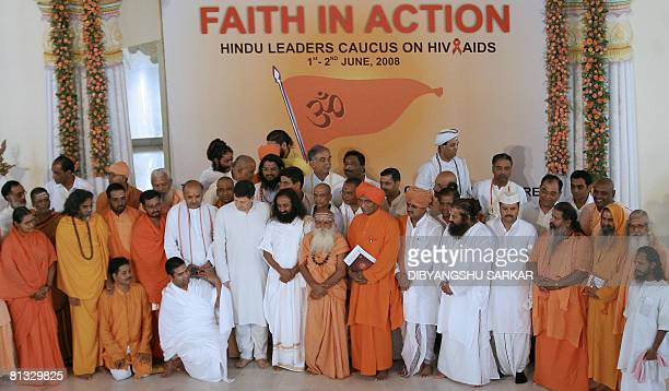 The founder of Art of Living Sri Sri Ravi Shankar stands alongside other Hindu religious leaders as they attend a session during the second day of a...