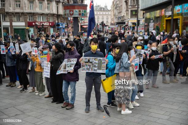 The founder of Hong Kong Liberty and Stand with Hong Kong, Finn Lau , seen holding the Apple Daily 25th Anniversary magazine during the...