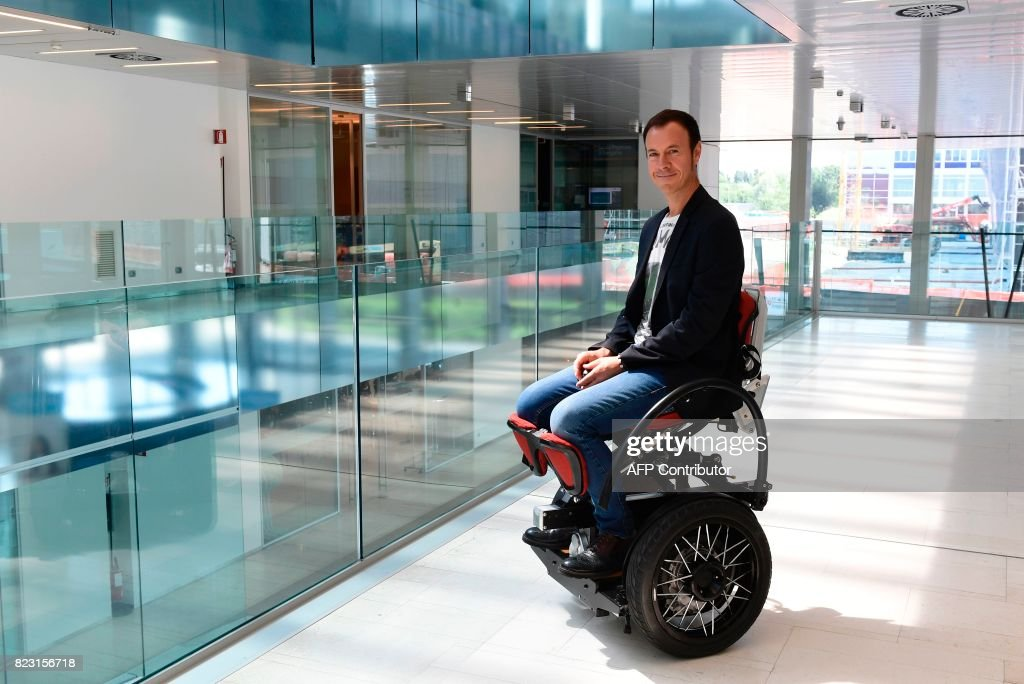 Mario Vigentini shows his creation, a hands-free electrical wheelchair that places the person at the same height as a standing person.