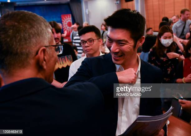 The founder of the dissolved prodemocracy Future Forward Party Thanathorn Juangroongruangkit makes an elbow greeting after speaking at a forum at the...