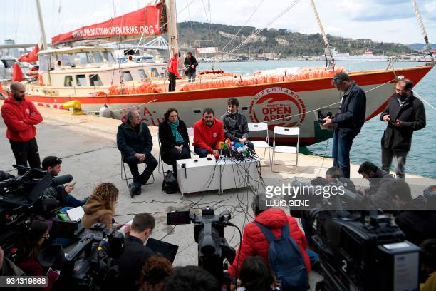 The founder of the Spanish NGO Proactiva Open Arms Oscar Camps gives a press conference next to Spanish singer Joan Manuel Serrat the mayor of...
