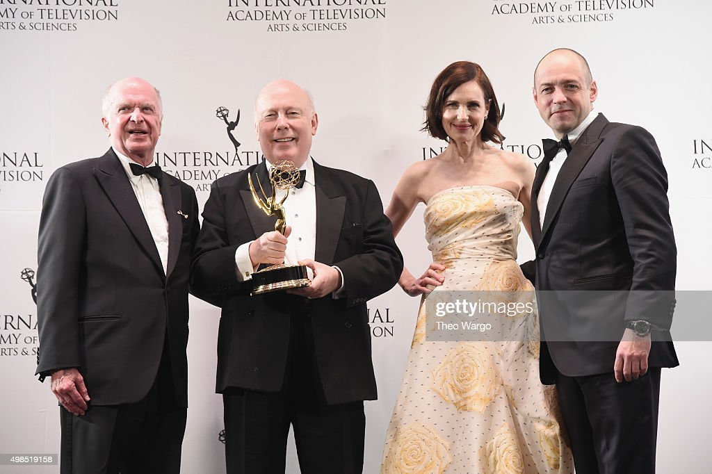 The Founders Award recipient, Writer & Creator, 'Downton Abbey' Julian Fellowes (2nd L) celebrates with presenters Elizabeth McGovern and Gareth Neame and President & CEO of of the The International Academy of Television Arts & Sciences Bruce Paisner (L) at 43rd International Emmy Awards at New York Hilton on November 23, 2015 in New York City.