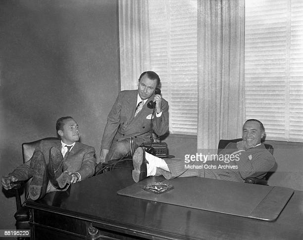The founders of Capitol Records pose for a photo in their Sunset Blvd offices on July 21 1943 in Los Angeles California