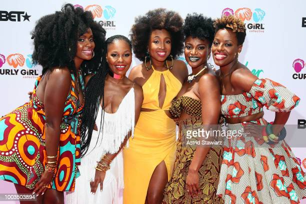 Model Bre Scullark poses with the founders of Curly Girl Collective Simone Mair Tracey Coleman Gia Lowe Charisse Higgins and Melody Henderson at...