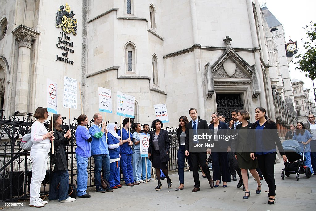 The founding members of the Justice for Health group walk toward the entrance as junior doctors and supporters rally outside the Royal Courts of Justice, Strand on the first day of their hearing as they challenge the government's plan for a seven-day NHS service, on September 19, 2016 in London, England. Justice for Health was founded in March 2015 by five frontline junior doctors to mount a legal challenge against the proposals by Jeremy Hunt, the Secretary of State for Health, to provide a full NHS service over the weekend, despite claims by opponents that the plan is under-funded and has not been fully considered.
