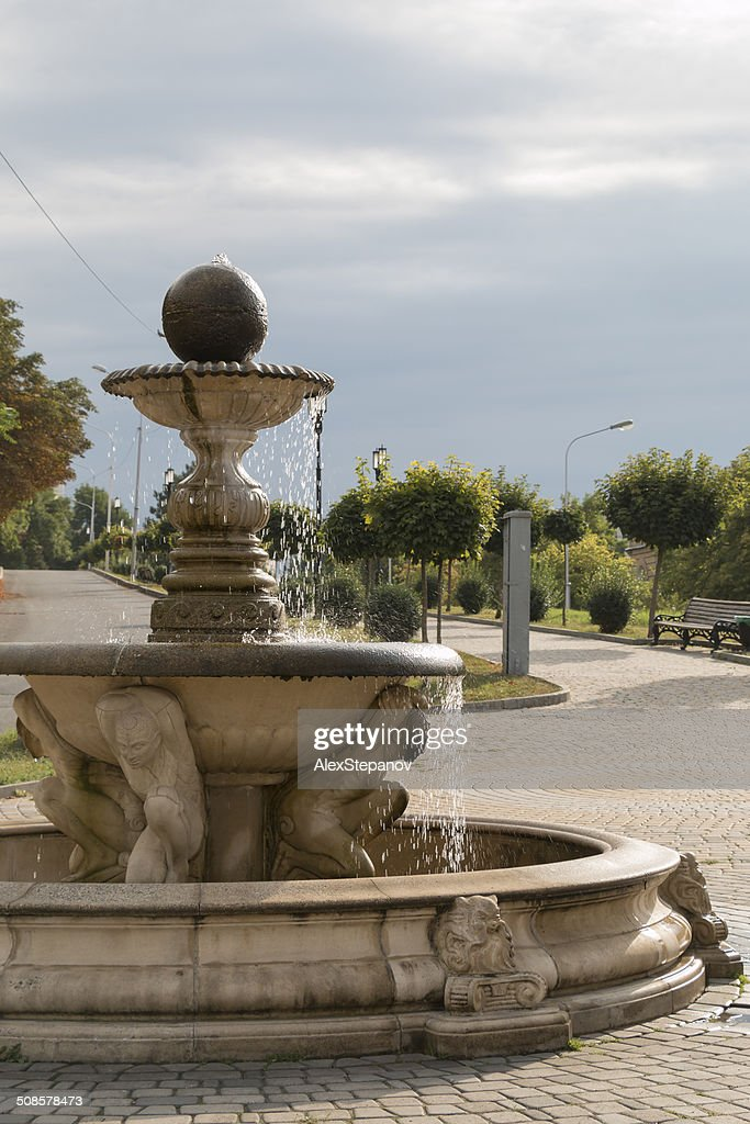 The fountain in the morning sun in the street : Stock Photo