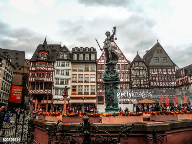 The fountain of Justice in the center of the old city center (Roemer) in Frankfurt - Frankfurt am Main, Hesse, Germany, Europe
