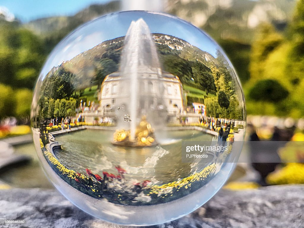 The fountain of Linderhof Castle through a lensball : Stock Photo