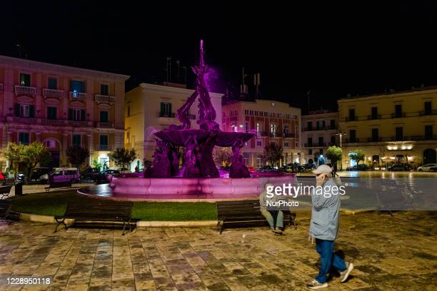 The Fountain of the Tritons in Piazza Vittorio Emanuele in Giovinazzo illuminated in pink on the occasion of the Giro d'Italia starting from...