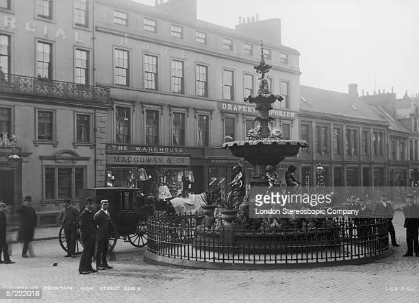 The fountain on the High Street in Dumfries, in the south west of Scotland, circa 1900.