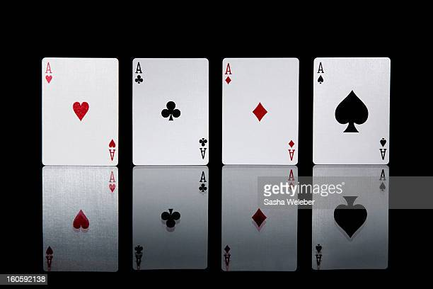 The four aces from a pack of playing cards
