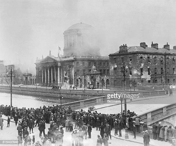 The Four Courts in Dublin burn after Irish Free State troops fired upon it to drive out Irish Republican rebels who occupied it in protest over the...
