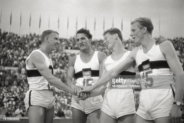 The four German athletes Bernd Cullmann Armin Hary Walter Mahlendorf and Martin Lauer rejoicing They won the Olympic gold medal in 4x100 m relay Rome...