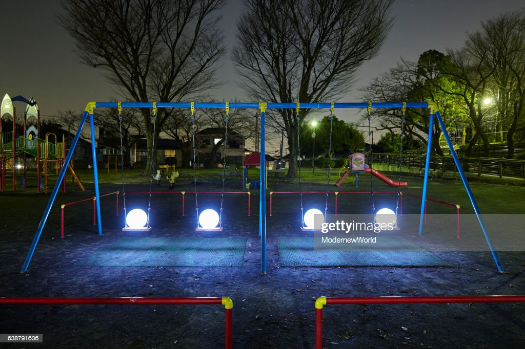 The four Led balls on the swing set : Stock Photo
