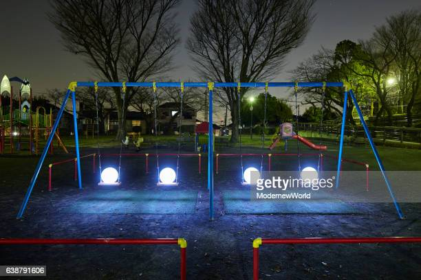 The four Led balls on the swing set