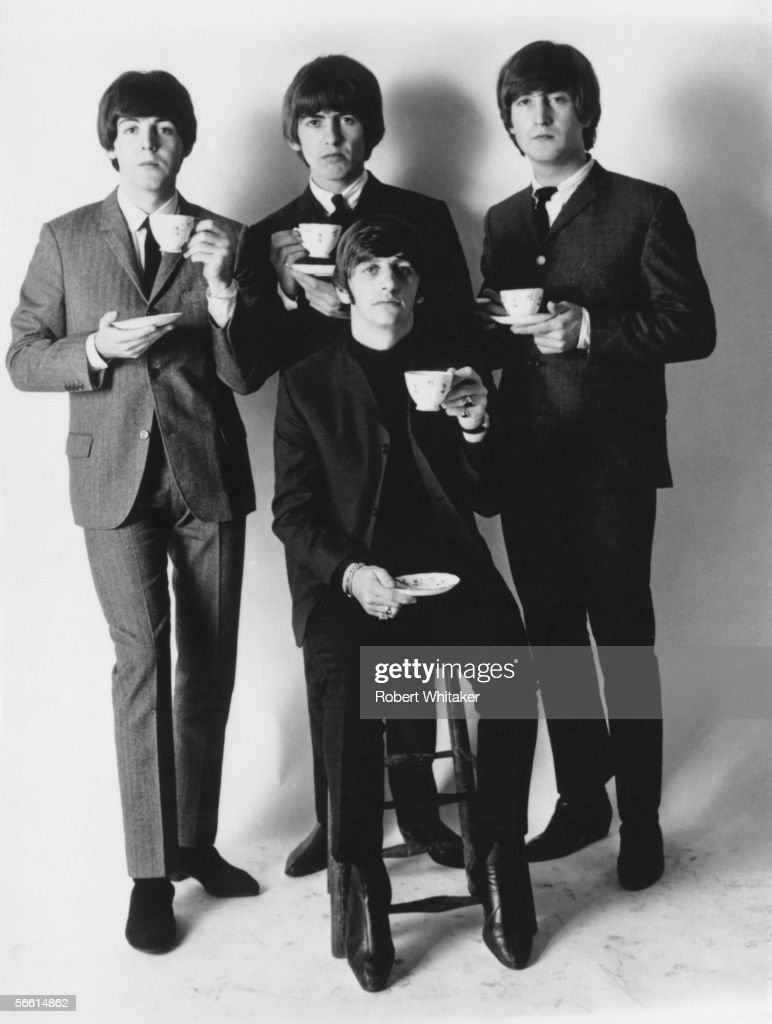 The Four Members Of Beatles Posing With Cups Tea From Left