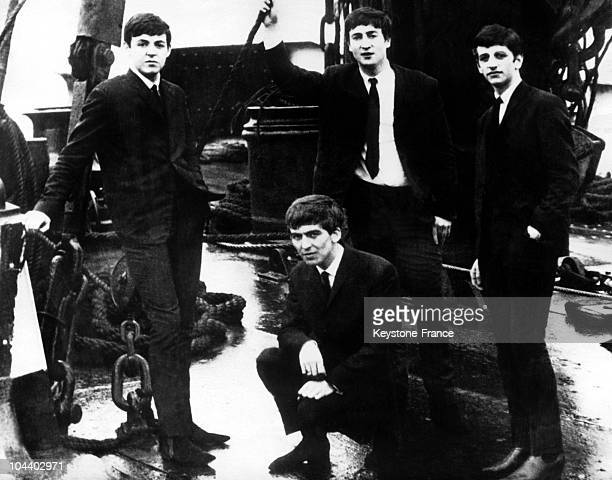 The four members of the group the BEATLES at their debuts around 1960