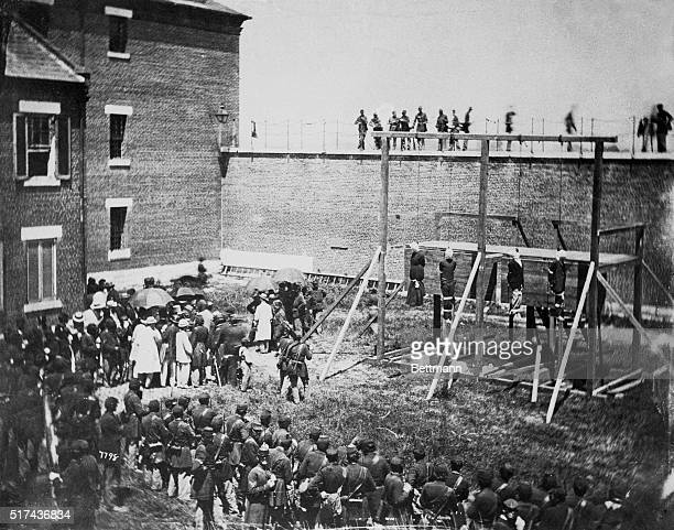 The four people condemned to death for conspiring in the Lincoln assassination hang from a gallows in a prison yard on July 7 1865 Three men and one...