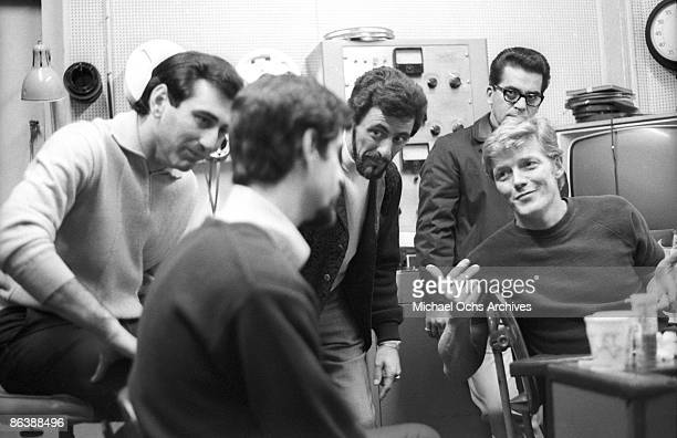 The Four Seasons listen to a playback in the studio on April 19 1967 in New York City New York