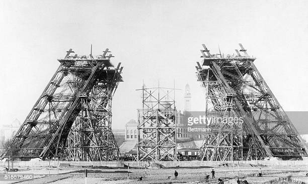 The four sloping legs of the Eiffel Tower undergo construction in 1887 at the ChampdeMars in Paris Civil engineer Gustave Eiffel designed the unique...