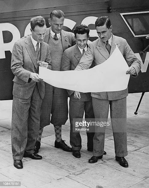 The fourman crew of the Fokker F VIIb trimotor monoplane Southern Cross study a map of their route at Croydon airport London 24th June 1930 They are...
