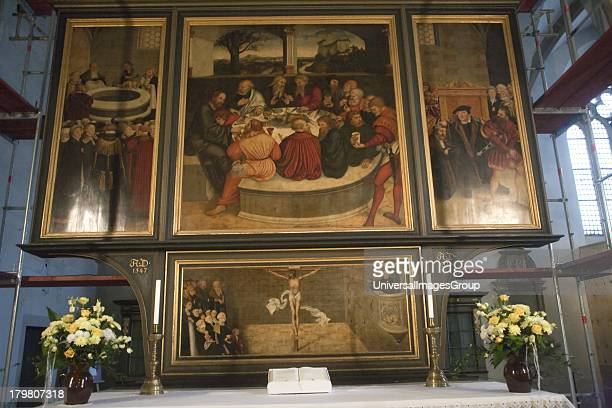 The fourpanel Reformation Altar of 1547 in St Marys the Town Church of Wittenberg Germany an UNESCO World Heritage Site is the work of Lucas Cranach...