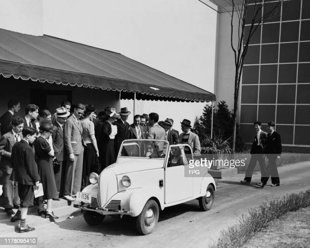 The four-person Crosley small car at the 1939/1940 New York World's Fair, USA, 1939. It has two cylinders, goes 50 miles on a gallon of gas and costs...