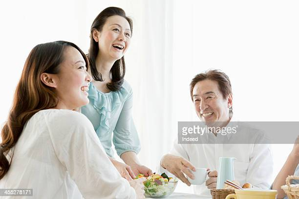 The four-person family surrounding a table
