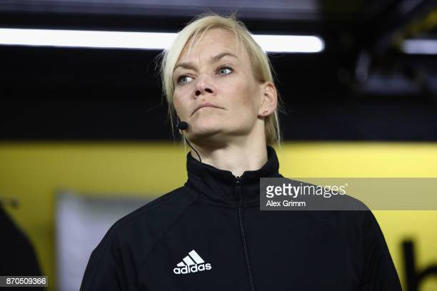 The fourth official Bibiana Steinhaus looks on prior to the Bundesliga match between Borussia Dortmund and FC Bayern Muenchen at Signal Iduna Park on...