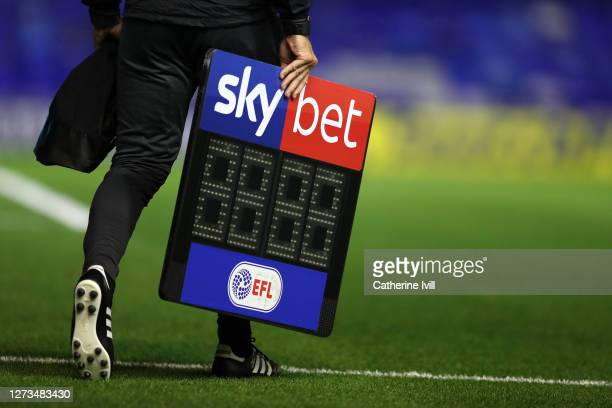 The fourth official carrys the Sky Bet EFL substitutes board across the pitch ahead of the Sky Bet Championship match between Coventry City and...