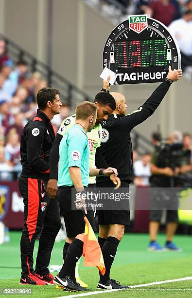 The fourth official displays the electronic substitution board during the Premier League match between West Ham United and AFC Bournemouth at London...