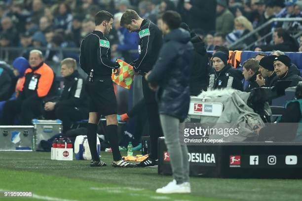 The fourth official Guido Kleve speaks with referee Benjamin Brand comes on as a new linesman after Robert Schroeder got injured during the...