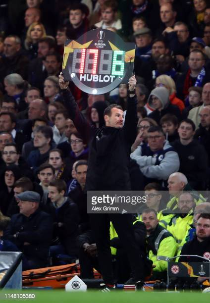 The fourth official holds the substitution board during the UEFA Europa League Semi Final Second Leg match between Chelsea and Eintracht Frankfurt at...
