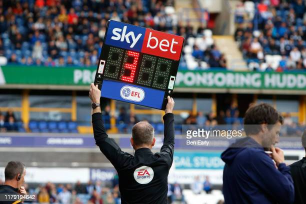 The fourth official holds up the board for 3 minutes extra time during the Sky Bet Championship match between Huddersfield Town and Hull City at John...