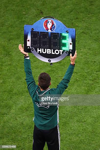 The fourth official holds up the board to announce the substitution during the UEFA EURO 2016 Group E match between Belgium and Italy at Stade des...