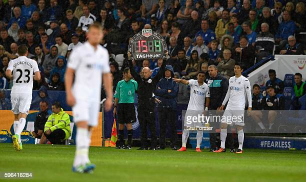 The fourth official holds up the substitute board during the Premier League match between Leicester City and Swansea City at The King Power Stadium...