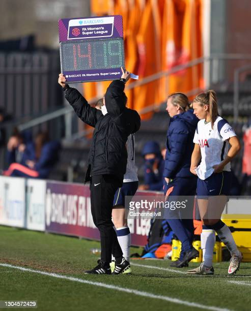 The fourth official holds up the substitutes board during the Barclays FA Women's Super League match between Tottenham Hotspur Women and Everton...