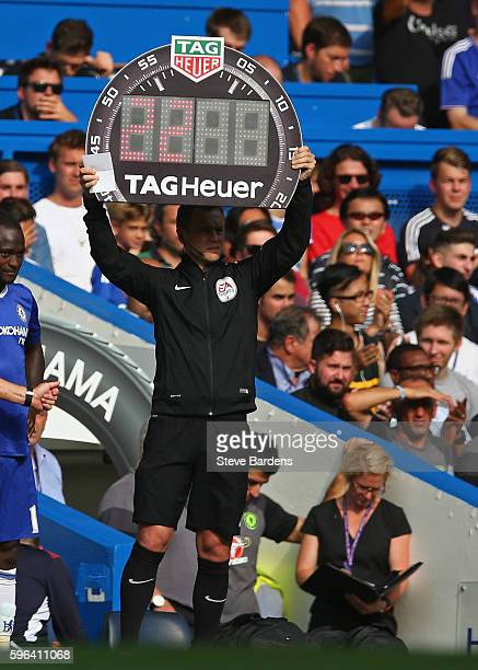The Fourth Official holds up the substitutes board during the Premier League match between Chelsea and Burnley at Stamford Bridge on August 27 2016...