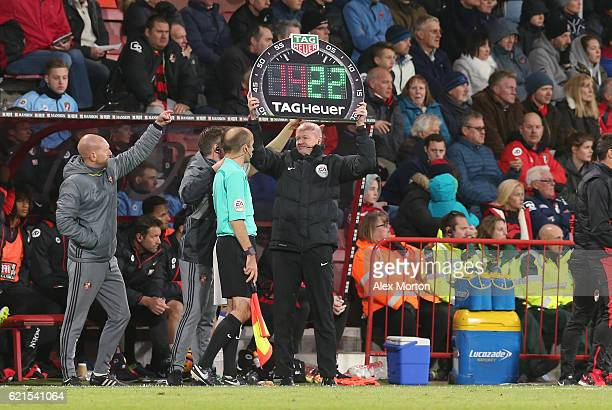 The fourth official holds up the substitution board during the Premier League match between AFC Bournemouth and Sunderland at Vitality Stadium on...