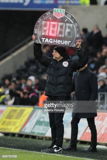 The fourth official shows 10 minutes of extra time during the Premier League match between Swansea City and West Ham United at The Liberty Stadium on...