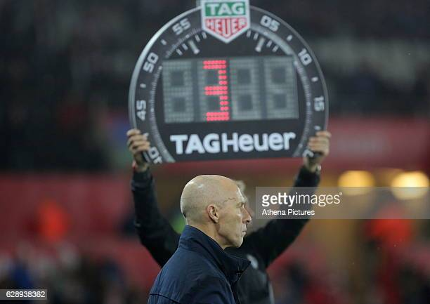 The fourth official shows three minutes of extra time over Swansea City manager Bob Bradleyduring the Premier League match between Swansea City and...