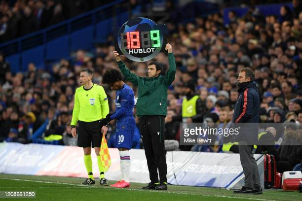 The fourth official signals for a substitution during the UEFA Champions League round of 16 first leg match between Chelsea FC and FC Bayern Muenchen...