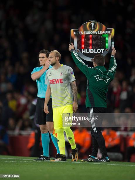 The fourth officlal holds up the electronic board displaying details of the substitution during the UEFA Europa League match between Arsenal FC and...