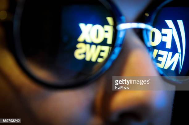 The Fox News logo is seen reflected in a pair of sunglasses on November 3 2017