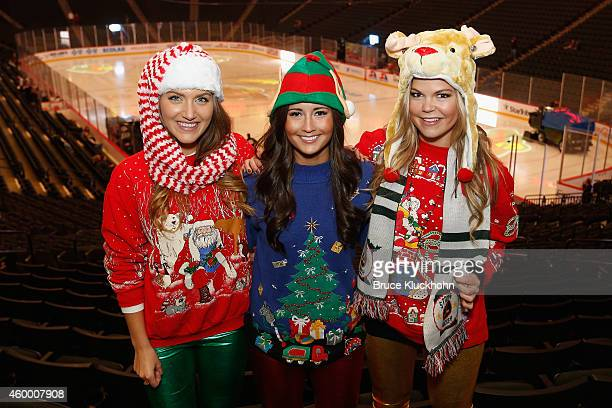 The Fox Sports North Girls Jennifer Angie and Kendall pose for a picture in their ugly Christmas sweaters prior to the game between the Anaheim Ducks...