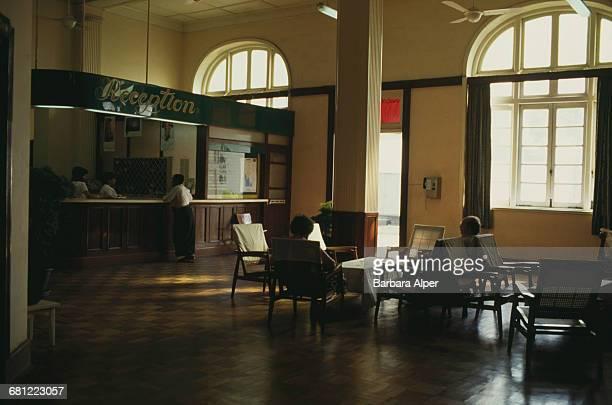 The foyer and reception of the Strand Hotel in Rangoon , Burma , February 1988.