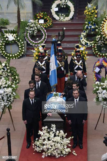 The frag-draped coffin of Guatemala City Mayor and former Guatemalan President Alvaro Arzu is escorted by his sons and grandchildren during a...